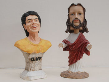 picture showing the cliff statuette with bobblehead jesus