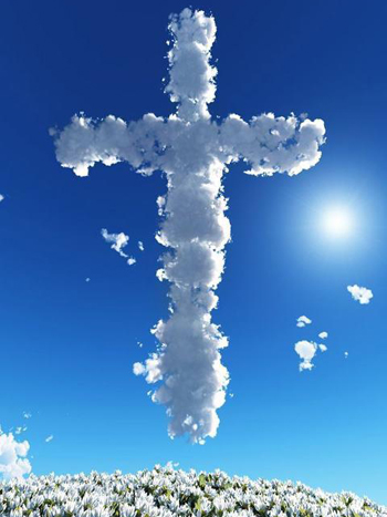 Photo of a cross in the clouds, with more than a little help from Photoshop